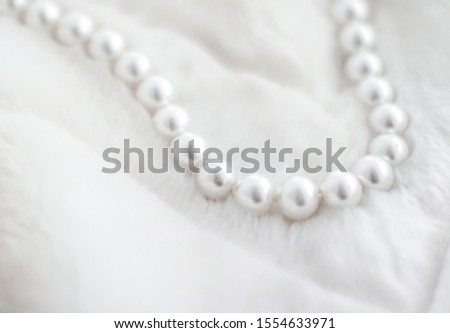 Jewelry branding, elegance and sale concept - Winter holiday jewellery fashion, pearl necklace on fur background, glamour style present and chic gift for luxury jewelery brand shopping, banner design #1554633971