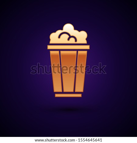 Gold Popcorn in cardboard box icon isolated on dark blue background. Popcorn bucket box.  Vector Illustration #1554645641