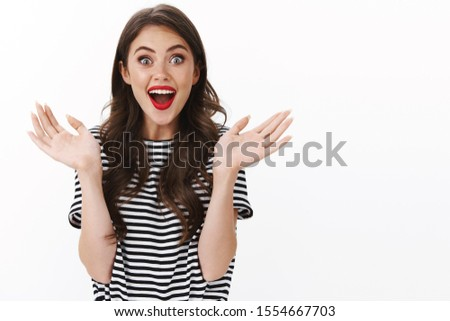 Cheerful enthusiastic amused alluring woman clasping hands entertained, watching wonderful theatre play, open mouth fascinated and ambushed, see breathtaking performance, happy applause #1554667703