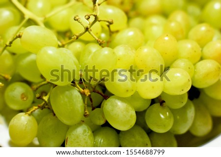 Ripe grapes of different varieties on a plate #1554688799