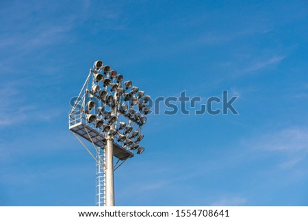 Stadium light over soccer field with blue sky background, copy space. #1554708641