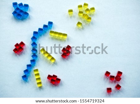 Building blocks illustrating concepts of design, construction, science, medicine, society, economy. Colorful - red, blue, yellow. #1554719324