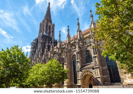 Ulm Minster or Cathedral of Ulm city, Germany. It is a famous landmark of Ulm. Panorama of ornate facade of Gothic church in summer. Nice scenery of medieval European architecture on sunny day. #1554739088