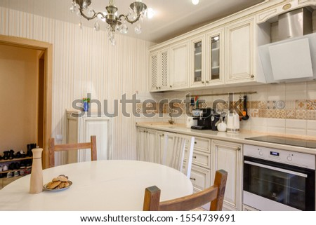 Russia, Moscow- June 10, 2019: interior room apartment. standard repair decoration in hostel. kitchen and dining room #1554739691