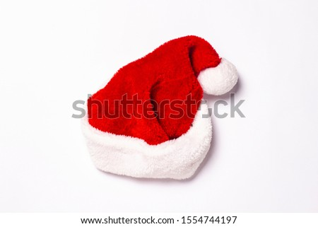 Santa Claus hat on a white background. Christmas concept, holiday. Isolate Flat lay, top view