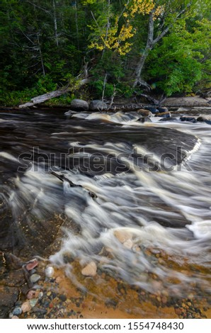 The Hurricane River rushes to it's meeting the waters of Lake Superior, just a few hundred feet away, Pictured Rocks National Lakeshore, Alger County, Michigan