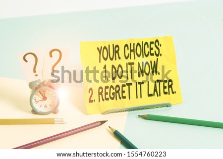 Text sign showing Your Choices 1 Do It Now 2 Regret It Later. Conceptual photo Think first before deciding Mini size alarm clock beside stationary placed tilted on pastel backdrop. #1554760223