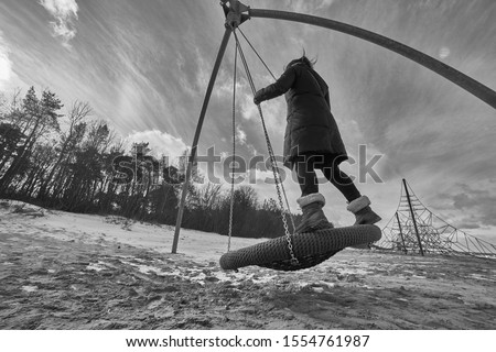 girl have fun at swing Royalty-Free Stock Photo #1554761987