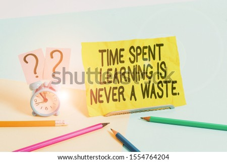 Text sign showing Time Spent Learning Is Never A Waste. Conceptual photo education has no end Keep learning Mini size alarm clock beside stationary placed tilted on pastel backdrop. #1554764204