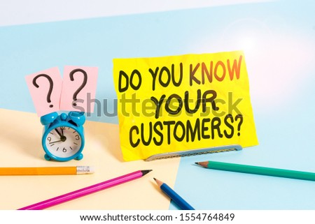 Text sign showing Do You Know Your Customers question. Conceptual photo asking to identify a customer s is nature Mini size alarm clock beside stationary placed tilted on pastel backdrop. #1554764849