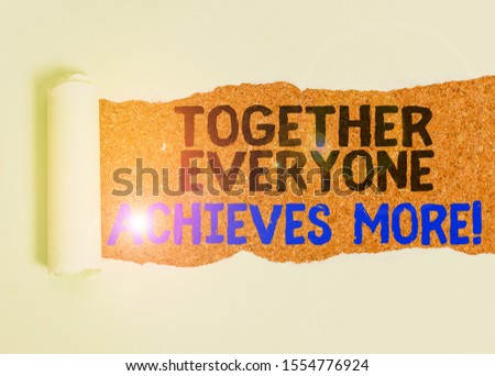 Writing note showing Together Everyone Achieves More. Business photo showcasing Members create synergy with strong sense mutual commitment Cardboard which is torn placed above a wooden classic table. #1554776924