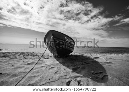 Wide angle shot of the boat. Wooden boat at sea cost Royalty-Free Stock Photo #1554790922