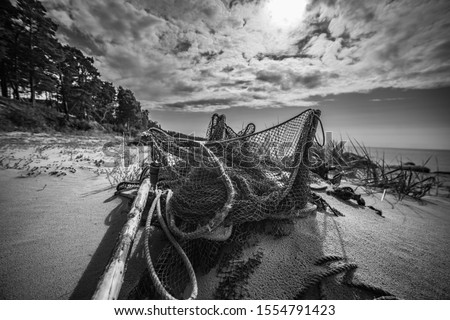 Wide angle shot of fishing net Royalty-Free Stock Photo #1554791423