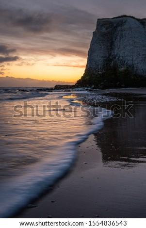 Waves lapping at the shoreline during a golden sunrise at the beach - Botany Bay  #1554836543