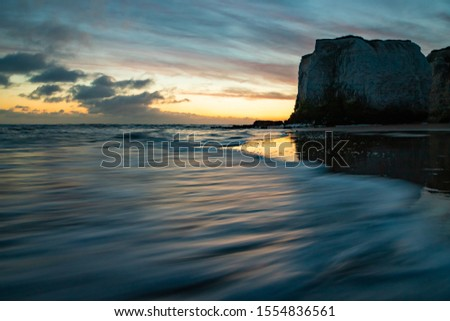 Waves lapping at the shoreline during a golden sunrise at the beach - Botany Bay  #1554836561