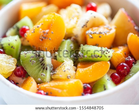 Healthy summer Breakfast concept, fruit salad in  a white bowl. Vegetarian food concept. Weight loss concept. #1554848705