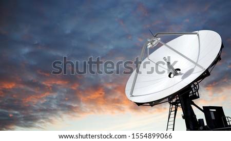 Big parabolic antenna against dramatic sky Royalty-Free Stock Photo #1554899066