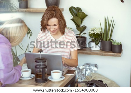 So pleased. Pleased girl keeping smile on her face while typing message #1554900008