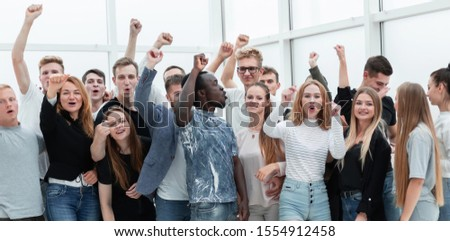 team of happy minded people showing their success Royalty-Free Stock Photo #1554912458