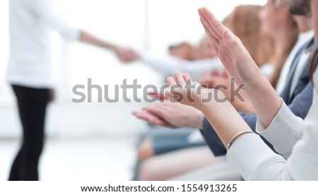 background image of a young business team applauding #1554913265
