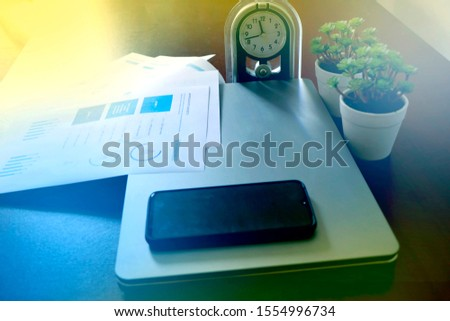 Corporate Business infograph checking sheet along with Laptop and Alarm Watch, Marketing & Finance Photo #1554996734