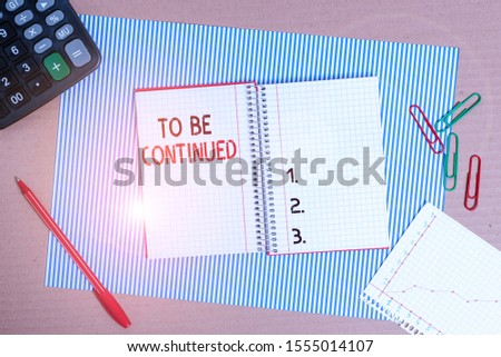Text sign showing To Be Continued. Conceptual photo indicate that the story continues in the next episode Striped paperboard notebook cardboard office study supplies chart paper. #1555014107