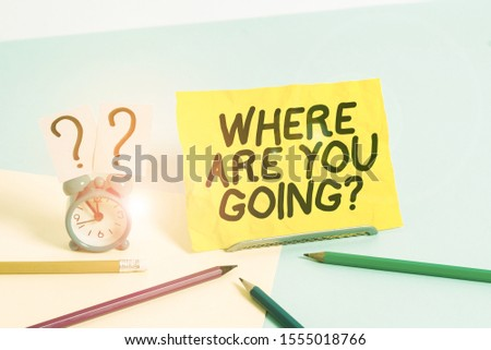 Text sign showing Where Are You Goingquestion. Conceptual photo used to ask someone the destination headed to Mini size alarm clock beside stationary placed tilted on pastel backdrop. #1555018766