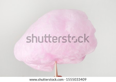 Sweet pink cotton candy on white background. #1555033409