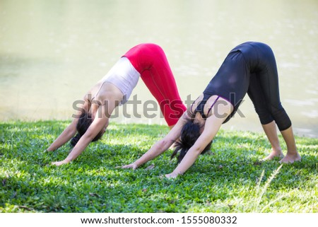 Two Asian women are practicing and doing morning yoga for good health. happily #1555080332