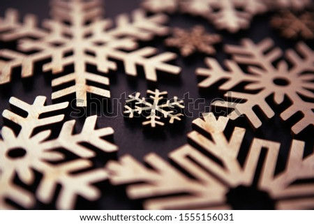 Rustic wooden snowflakes for Happy New Year and Christmas Eve celebration.Handmade crafts for winter holidays.Home decor and hand crafted toys for Christmas Tree decoration
