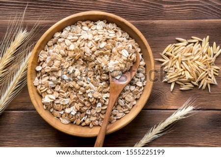 Oats, oat flakes and ear on wooden table, top view. Top view.  #1555225199
