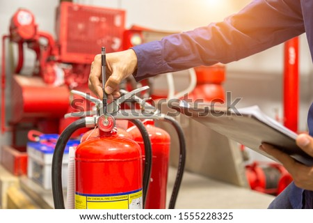 Engineer checking Industrial fire control system,Fire Alarm controller, Fire notifier, Anti fire.System ready In the event of a fire. #1555228325