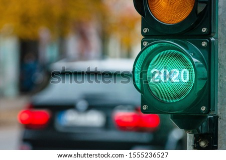 A city crossing with a semaphore. Green light with text 2020 in semaphore. New Year concept - image #1555236527