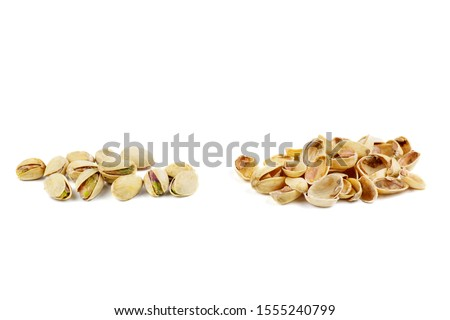Roasted pistachios and husks isolated on white background #1555240799