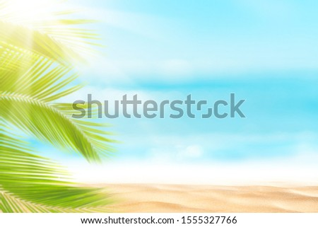 Blur beautiful nature green palm leaf on tropical beach with bokeh sun light wave abstract background. Copy space of summer vacation and business travel concept. Vintage tone filter effect color style #1555327766