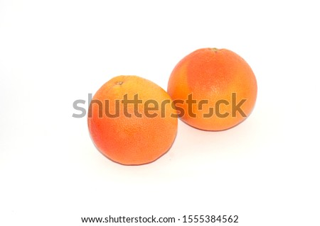 Two whole graTwo whole grapefruit on a white background isolate, copy spacepefruit on a white background isolate copy space #1555384562