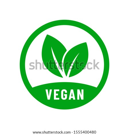 Vegan vector icon. Organic, bio, eco symbol. Vegan, no meat, lactose free, healthy, fresh and nonviolent food. Round green vector illustration with leaves for stickers, labels and logos Royalty-Free Stock Photo #1555400480