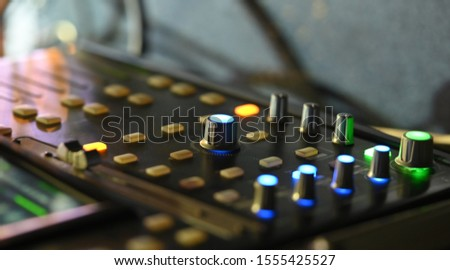 Audio sound mixer console with night time. #1555425527