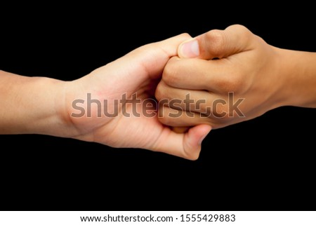 Isolated hands of male teenagers doing Ganesha Yoga Mudra with two hands-on black background.Horizontal shot. #1555429883