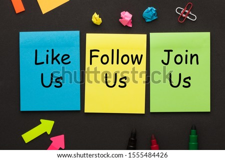 Like Us, Follow Us and Join Us text on color notes and office supplies on black background. Concept of social media marketing and management.  #1555484426