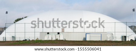 Mobile modern city basketball and football stadium made of an inflatable white  canvas dome. Panoramic urban collage #1555506041