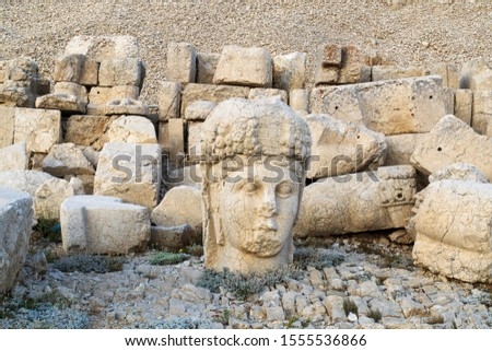 Ancient statues on the top of Nemrut mount, Turkey. The mount Nemrut is listed as UNESCO World Heritage since 1987 #1555536866
