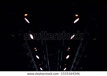 Spotlights on dark podium. Catwalk stage spotlights #1555564346