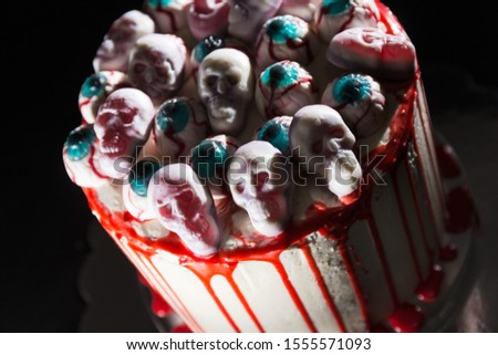 Drip cake on the day of the dead, traditional Mexican celebration, themed skulls and blood, on black background