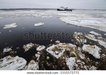 Autumn ice drift on the river. Ice floes on the river Northern Dvina. Arkhangelsk #1555573775