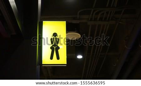 Lightbox Toilet Signage hang on wall