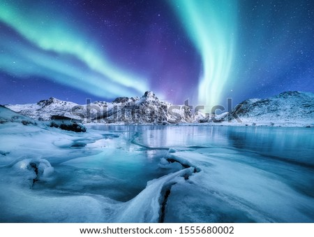 Aurora Borealis, Lofoten islands, Norway. Nothen light, mountains and frozen ocean. Winter landscape at the night time. Norway travel - image #1555680002