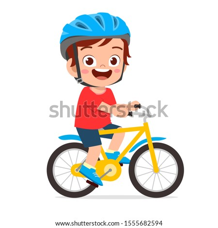 happy cute kid boy riding bike smile
