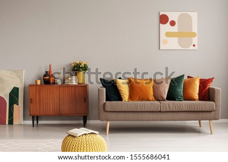 Retro style in beautiful living room interior with grey empty wall #1555686041