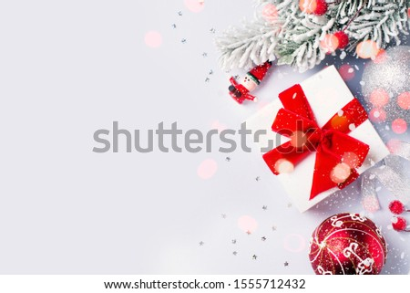 Christmas gift box flat lay on white background with decoration. Happy new year background and backdrop, copy space, top view #1555712432